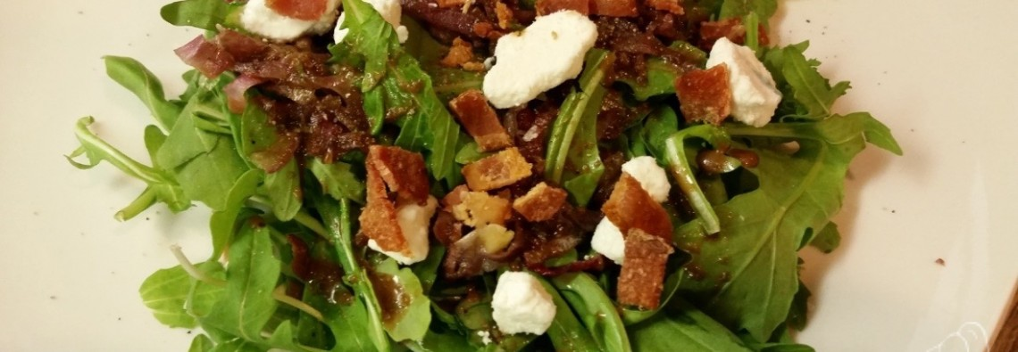 Arugula Salad with Caramelized Onion, Bacon, Goat Cheese, and Fig-Balsamic Vinaigrette